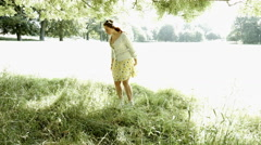 Young woman with yellow dress and cardigan Stock Footage