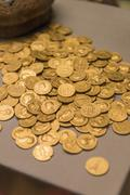Golden British coins pounds - stock photo