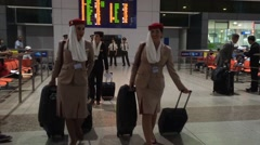 Hostess and pilots in Saigon airport Stock Footage