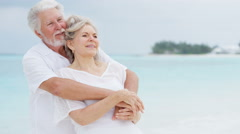 Loving retired senior Caucasian couple on a tropical beach - stock footage
