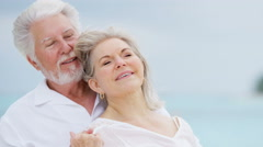 Romantic mature Caucasian couple outdoors together on tropical beach Stock Footage
