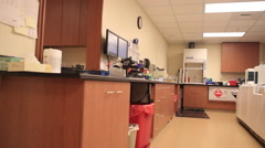 Pan of Blood lab with person Stock Footage