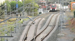 Passenger train approaches and passes below Stock Footage