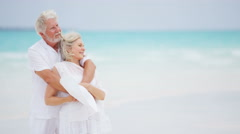 Happy Caucasian senior retired couple together on a tropical beach - stock footage