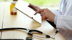 Stethoscope with female doctor using tablet computer in medical clinic Stock Footage