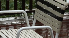 Wet vinyl deck chair. Raindrops on frame and webbing. Stock Footage