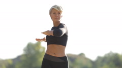 Fitness trainer doing workout at sunset Stock Footage