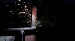 Welder working an industrial sander grinder for metal - stock footage