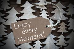 Brown Christmas Label With Enjoy Every Moment Stock Photos