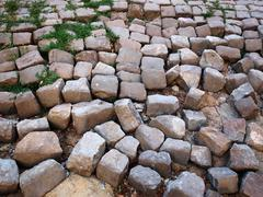 Old collapsed pavement - stock photo