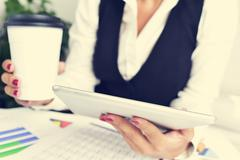 Businesswoman using a tablet computer Kuvituskuvat