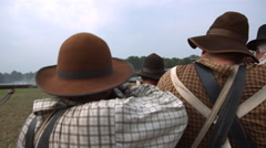 Civil War Reenactors Row of Soldiers Lined up, aim & shoot guns, Slo mo MCU - stock footage