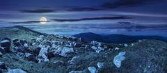 Stones in valley on top of mountain range at night Kuvituskuvat