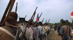 Civil War Reenactors Row of Soldiers Lined up, aim guns, Slo mo WS - stock footage