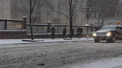 Traffic passing Morgan Library in Heavy Snow or Blizzard NYC Stock Footage