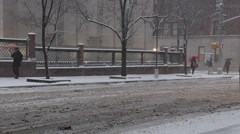 Stock Video Footage of Minimal traffic and Pedestrians pass Morgan Library in New York City Blizzard