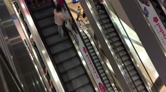 Top view of people on escalators in a mall Stock Footage