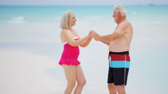 leisure travel Caucasian couple seniors swimwear dance health insurance tourism - stock footage