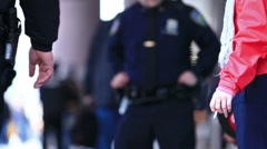 Police Officers in Uniform - NYPD cop un on waist, person smoking cigarette NYC Stock Footage