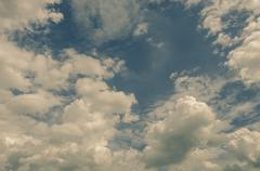 Stock Photo of Nice clouds in bright sky in vintage color style