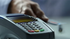 Credit card being processed through scanner Stock Footage