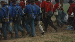 Civil War Reenactors rows of uniformed soldiers walking away, Slo mo Stock Footage