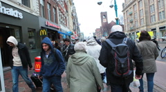 Amsterdam, The Netherlands. Holland. Street, city, people. Commerce, consumerism - stock footage