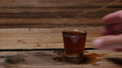 WHISKEY / LIQUOR SHOT.  NUMBER 5 IN A SERIES OF 7. Stock Footage