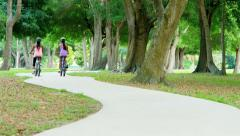 Young active multi ethnic girls riding bikes outdoor - stock footage