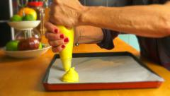 Woman in kitchen using piping bag - Choux buns preparation Stock Footage