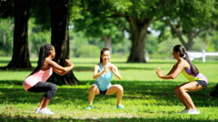 Young happy multi ethnic girls enjoying training outdoor - stock footage