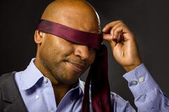 Blindfolded Businessman With Necktie - stock photo