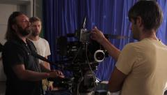 The cameraman and focuspuller at work on the set of the film. Film production Stock Footage