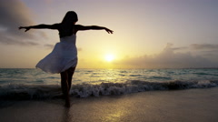 Carefree ethnic girl at luxury resort dancing barefoot - stock footage