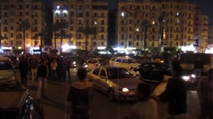 Egypt 2011 - pedestrians and traffic in Tahrir Square 01 - stock footage