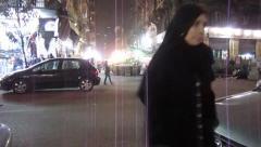 Egypt 2011 - woman crosses Cairo street at night Stock Footage