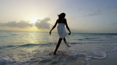 Carefree ethnic girl at luxury resort dancing barefoot in waves Stock Footage