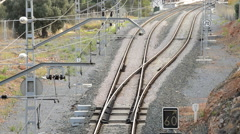 Passenger train emerging from a tunnel and away Stock Footage