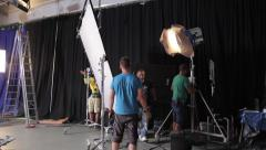 Stock Video Footage of Employees of the Studio set lighting fixtures on the set of the film