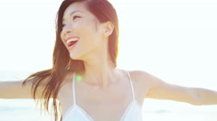 Social media portrait of beautiful ethnic female in white dress on beach - stock footage