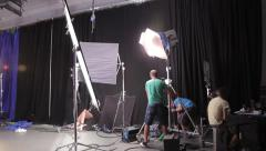 Stock Video Footage of Moving the lighting equipment on the set during the filming of the movie