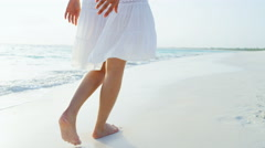 Legs of Asian Chinese female on vacation ocean beach - stock footage