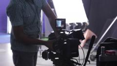 The cameraman changes the lenses in the camera. Film production - stock footage