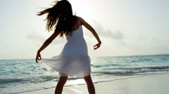 Ethnic girl at luxury resort dancing barefoot on beach - stock footage