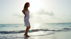 Barefoot Asian Chinese girl in white clothes on tropical beach Stock Footage
