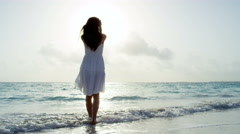 Ethnic Asian Chinese female at sunrise on vacation beach - stock footage