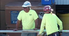 Two Construction Workers Talking - 4k Stock Footage
