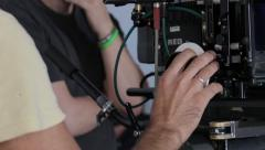 Focuspuller at work. Film production Stock Footage