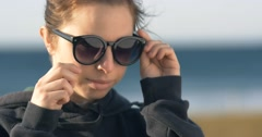 young adult model woman girl with sunglasses portrait - stock footage