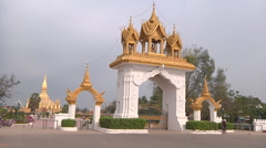 Archs and  Pha That Luang stupa in Vientiane, Laos Stock Footage